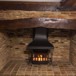 An anniversary Edition Thermovent high performance wood burning open fire in a newly modernisted cottage in Hertfordshire
