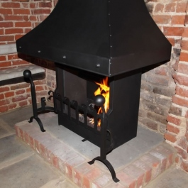 Anniversary Edition Thermovent high performance open fire with hand forged dog irons and grate front installed in this large Inglenook open fireplace.