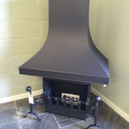 Camelot High Performance convecting open fire with on display in a retailers showroom.