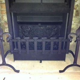 Clients antique dog irons and grate front re-worked to marry up to Thermovent high performance convecting open fire. Also show reclaimed fire back cut down to fit.