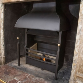 Georgian steel canopy on a Thermovent high performance wood burning open fire.