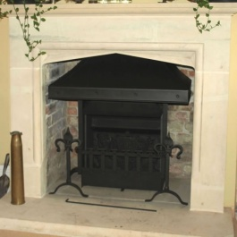 Hig performance open fire with convection system. Steel canopy clients dog irons