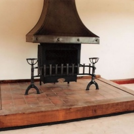 Highly bespoke woodburning Thermovent high performance convecting open fire on large barn conversion with heavy studed canopy and flane cut dog irons