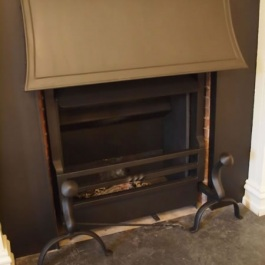 Inset panel used to cover unsightly brick previously built in on this fireplace. Thermovent wood burning open fire installed to give more heat with a period look.