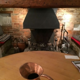 Large wood burning Inglenook fireplace with canopy in place when we surveyed. Replaced with a Thermovent high performance convection fire.