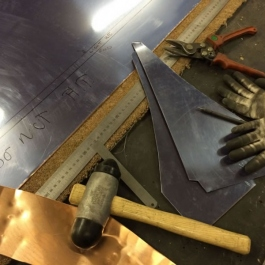 Marking out and cuting for a large hand beaten copper canopy.