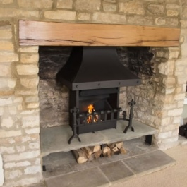 New oak beam installed in this Cotswold stone open fireplace when it was opened up.