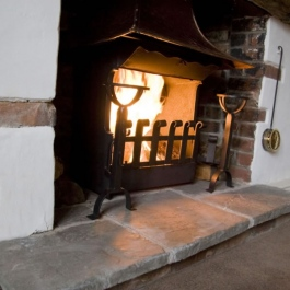 Open fireplace with Thermovent high performance wood burning convecting fire.