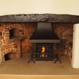 Traditional Open Fireplace with hand Forged Fire and Dog Irons