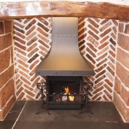 Re-built Inglenook with Camelot Thermovent fire featuring hand scored steel canopy and Spit dog irons