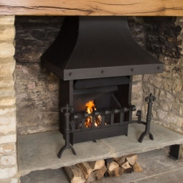 Remodelled open fireplace with raised hearth showing Thermovent convecting open fire with hand cast dog irons and scrool top dog irons.