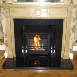 Rennovated polished granite fireplace with high perofrmance Thermovent open fire with built in convection system