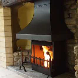 Small Inglenook open fireplace in modernised Cotswold cottage with Thermovent high performance convection fire with large canopy