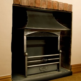 Small open fireplace with woodburning Thermovent high performance convecting open fire. Cottage style