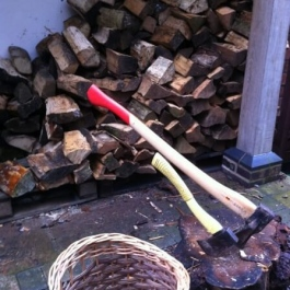 Splitting logs as we move them to the back of the house from the stores where they have been seasoned.