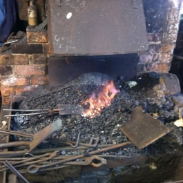 The forge used to hand craft our dog irons and grate fronts fired up and ready to go.