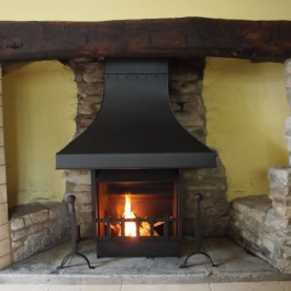 Thermovent convecting open fire installed in this small Inglenook open fireplace.