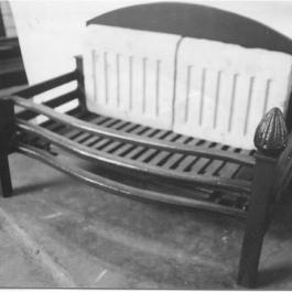 Traditional fire basket with bud top finials and three bar cast iron grate front.