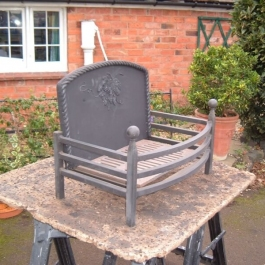 Traditional handmade fire basket with integral cast iron fireback