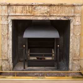 Unusual steel canopy in Georgian style on a Thermovent high performance wood burning open fire.