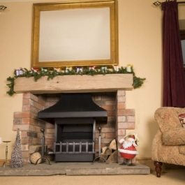 Wood burning thermovent convecting open fire in a medium size fireplace at Christmas time.
