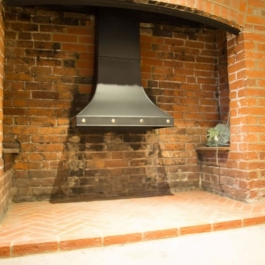 Hand made steel canopy with brass studs as requested by client for this Inglenook open fireplace. Canopy included a flue baffle control.