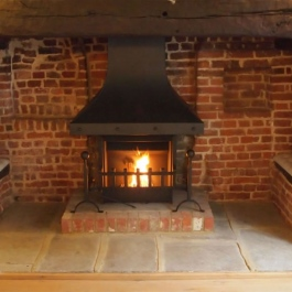 Large Inglenook with Camelot Thermovent open fire.