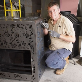 Paul Shaw working on modern open fire with floral pattern in Designfire has Thermovent high performance convecting fire inside