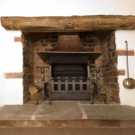 Rennovated cottage open fireplace with Thermovent high performance convecting fire.