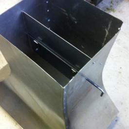 Steel canopy for an original woodburning fire arrangement showing a flue baffle control.