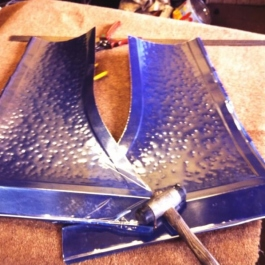 Two sides of a hand beatend copper canopy ready to be worked onto the steel canopy base. not the platic